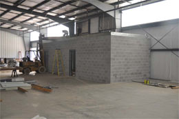 Shipping office and bathrooms. Wood decking being installed for HVAC and Platform.